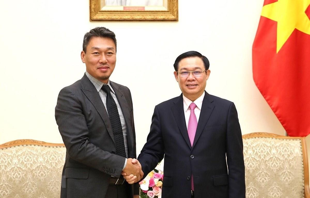 Phó Thủ tướng Vương Đình Huệ tiếp ông Park Byounggun, Giám đốc Công ty Công nghệ Alliex (Hàn Quốc). (Ảnh: Dương Giang/TTXVN)