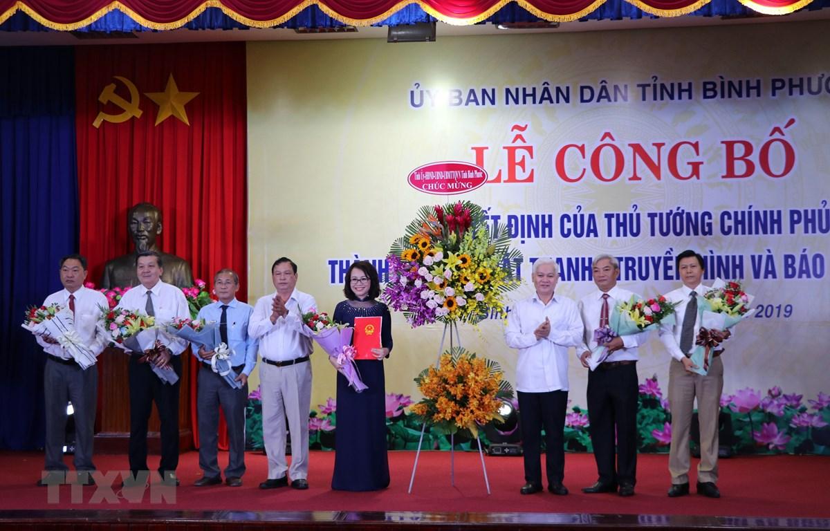 Lễ công bố và ra mắt lãnh đạo Đài Phát thanh - Truyền hình và báo Bình Phước. (Ảnh: Dương Chí Tưởng/TTXVN)