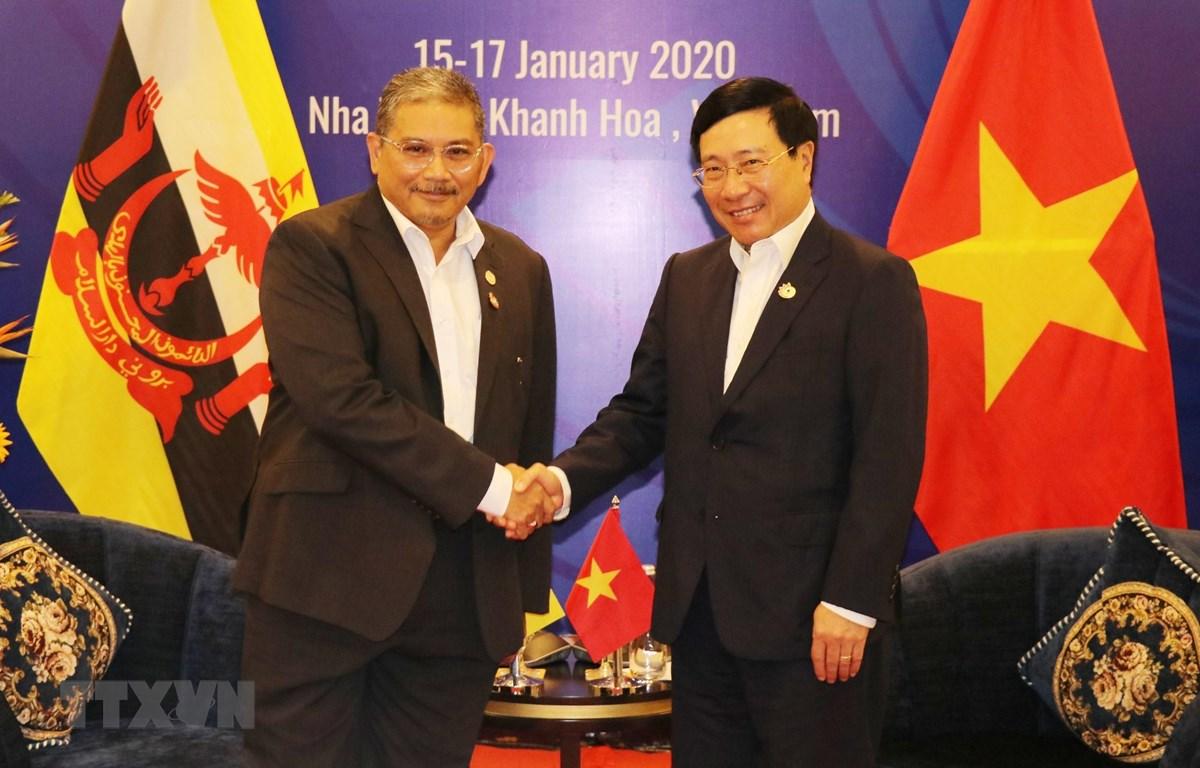 Phó Thủ tướng, Bộ trưởng Ngoại giao Phạm Bình Minh tiếp Bộ trưởng thứ hai Bộ Ngoại giao Brunei Darussalam Dato Erywan Pehin Yusof. (Ảnh: Tiên Minh/TTXVN)