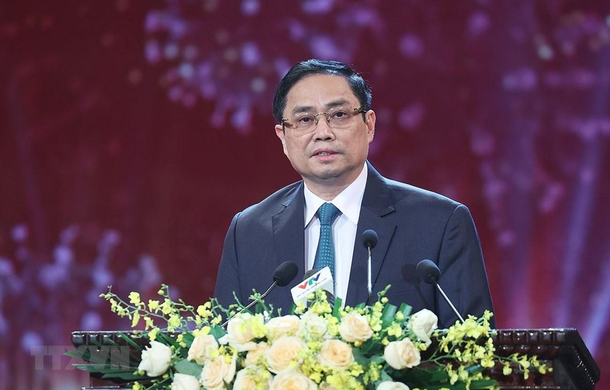 Thủ tướng Phạm Minh Chính kêu gọi đồng bào chiến sỹ cả nước, kiều bào ta ở nước ngoài chung sức đồng lòng với Chính phủ góp sức, góp tiền cho Quỹ vaccine. (Ảnh: Dương Giang/TTXVN)