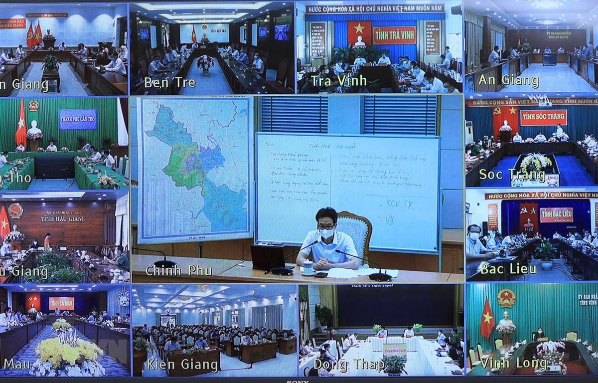 Phó Thủ tướng Vũ Đức Đam họp trực tuyến phòng, chống dịch COVID-19 với 12 tỉnh, thành phố phía Nam. (Ảnh: Lâm Khánh/TTXVN)