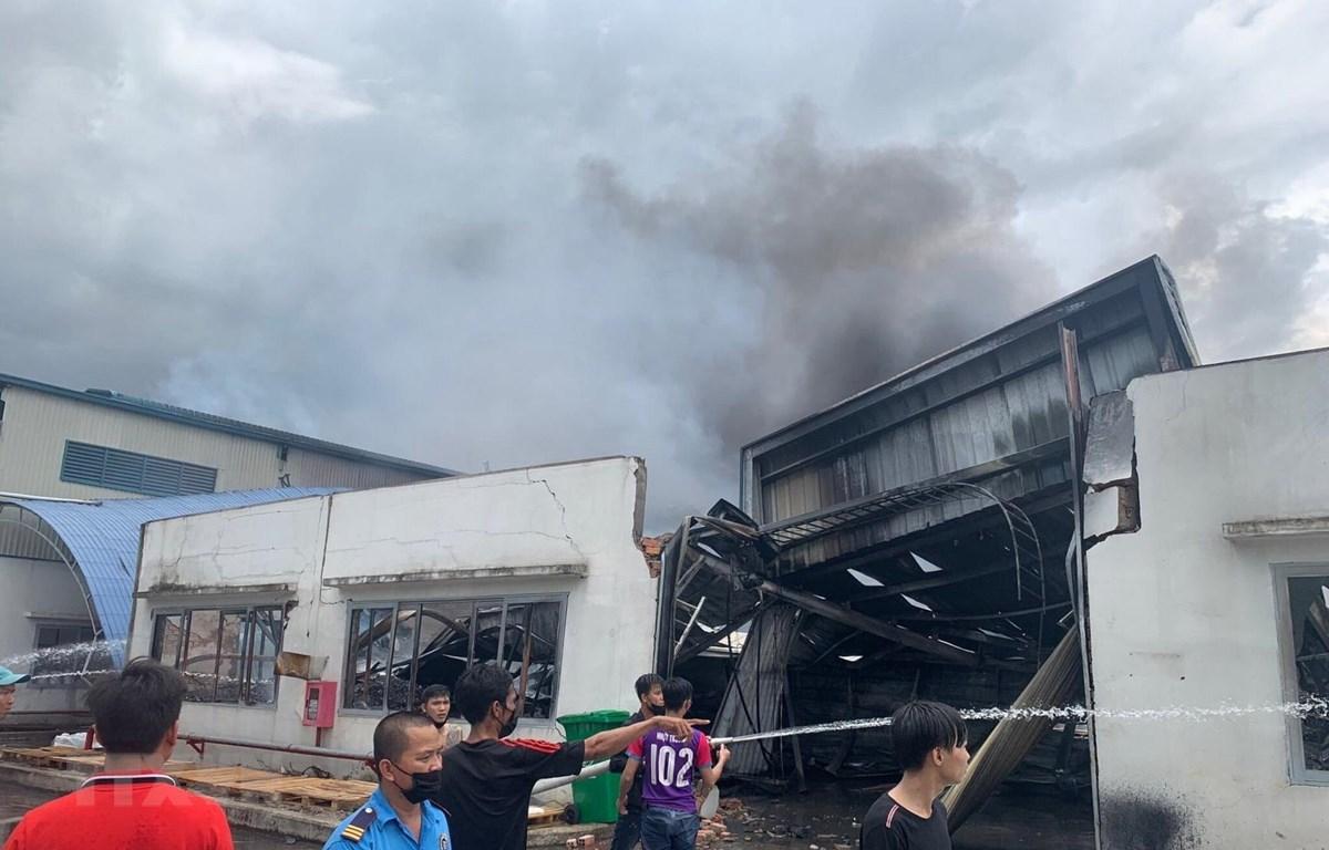 Hiện trường vụ cháy đã được khống chế. (Ảnh: Nguyễn Văn Việt/TTXVN)