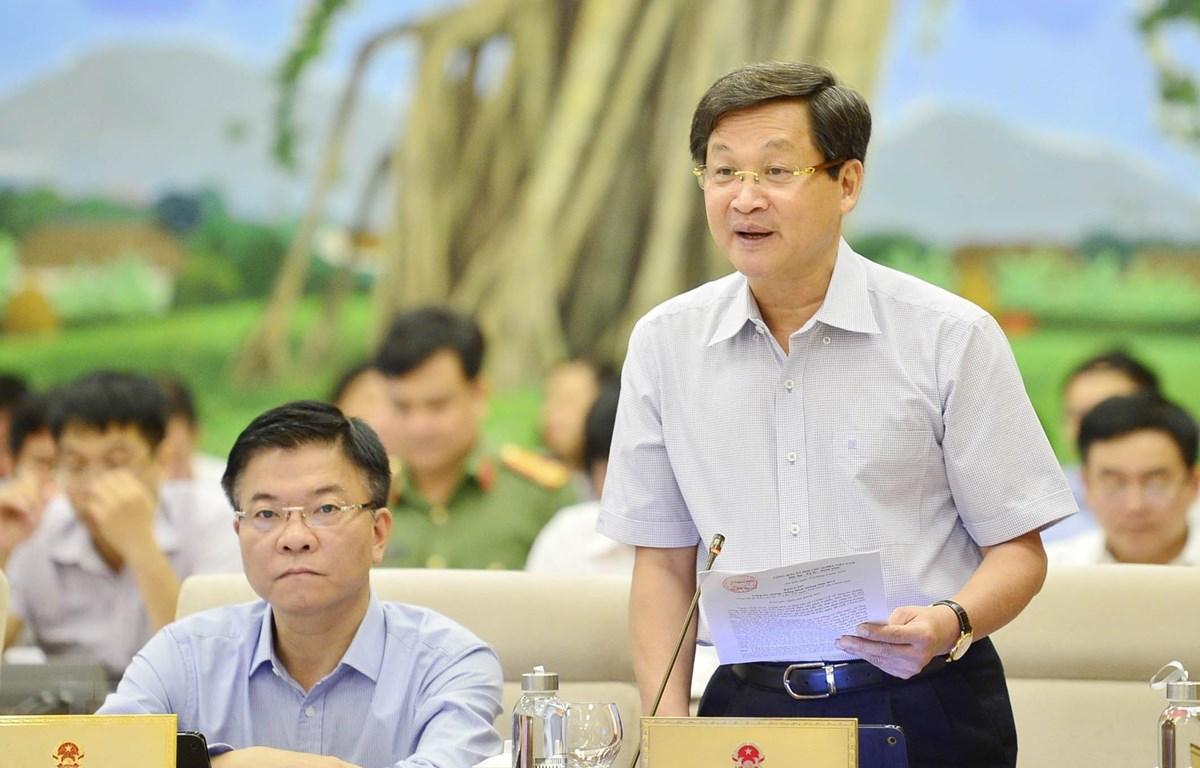 Tổng Thanh tra Chính phủ Lê Minh Khái trình bày báo cáo (tóm tắt) về công tác phòng, chống tham nhũng. (Ảnh: Trọng Đức/TTXVN)
