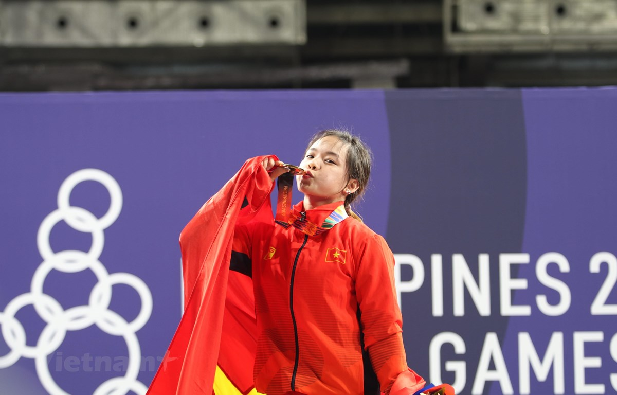 Hồng Thanh giành huy chương Vàng ở hạng cân 64kg môn Cử tạ. (Ảnh: Trần Giáp/Vietnam+)