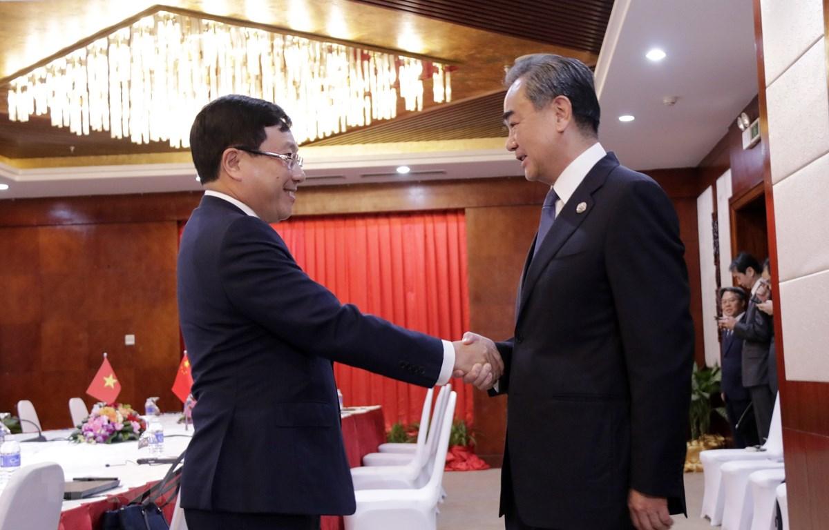 Phó Thủ tướng, Bộ trưởng Phạm Bình Minh và Ngoại trưởng Vương Nghị tại cuộc gặp. (Ảnh: Phạm Kiên/TTXVN)