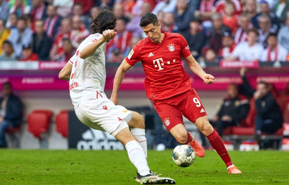 Bayern (áo đỏ) chiến thắng trong ngày Bundesliga trở lại sau dịch COVID-19. (Nguồn: Getty Images)