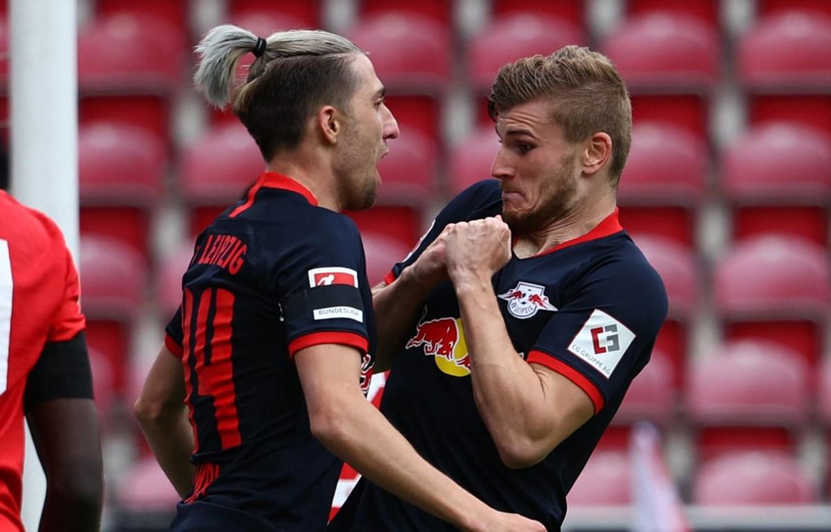 Werner (phải) ăn mừng cùng đồng đội sau khi lập công. (Nguồn: Getty Images)