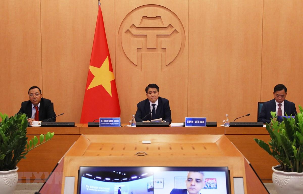 Chủ tịch Ủy ban nhân dân Thành phố Hà Nội Nguyễn Đức Chung dự Hội nghị cấp cao toàn cầu các thành phố về dịch Covid-19. (Ảnh: Lâm Khánh/TTXVN)