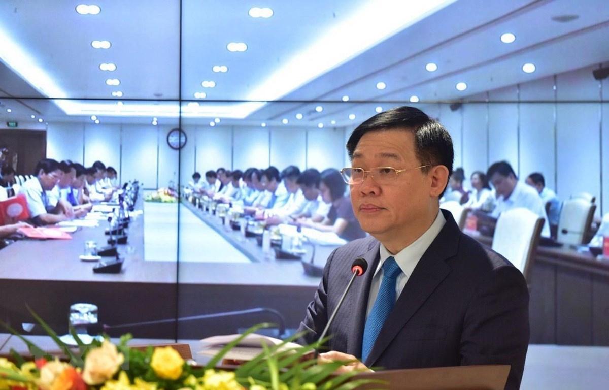 Bí thư Thành ủy Hà Nội Vương Đình Huệ phát biểu khai mạc hội nghị. (Ảnh: Văn Điệp/TTXVN)