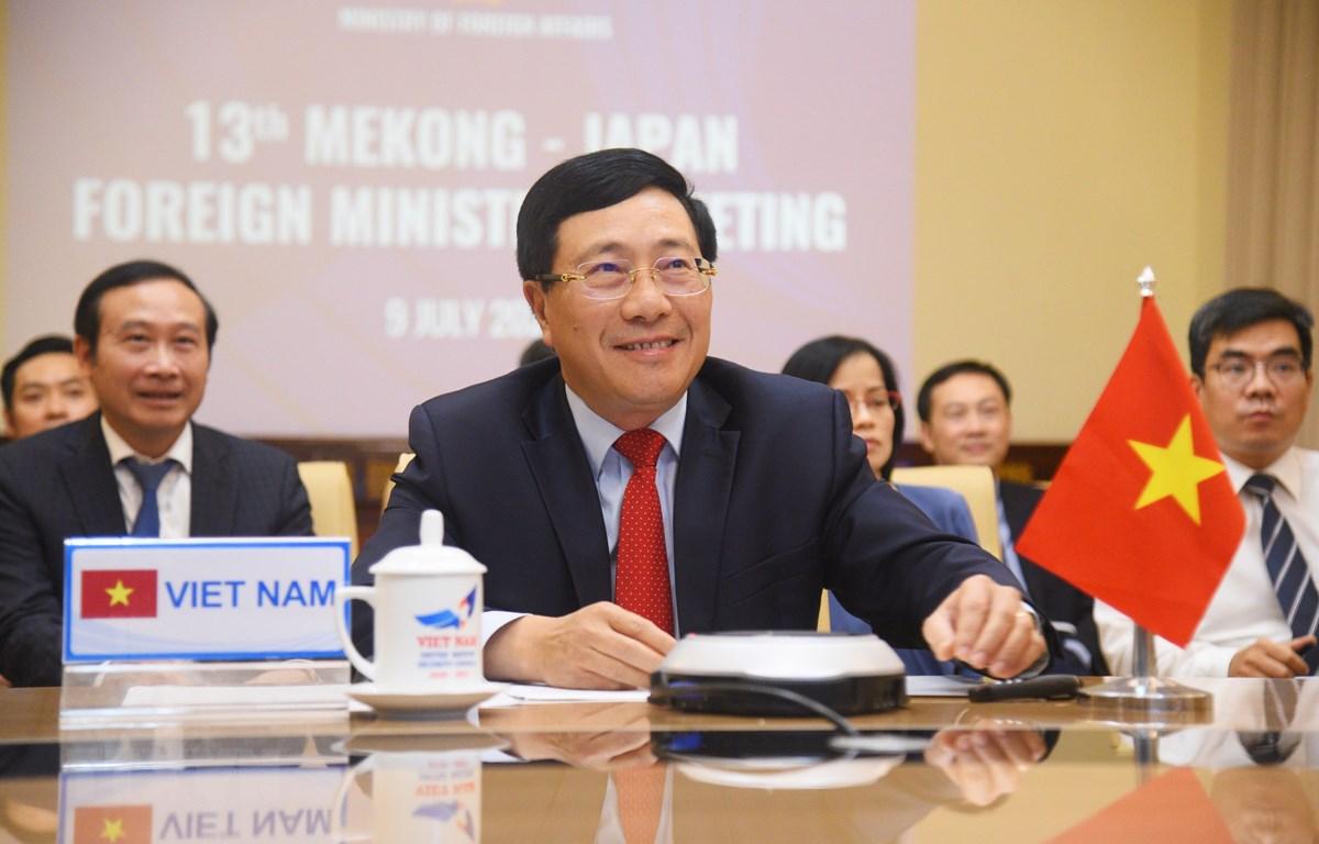 Phó Thủ tướng, Bộ trưởng Bộ Ngoại giao Phạm Bình Minh đồng chủ trì Hội nghị trực tuyến Bộ trưởng Mekong-Nhật Bản lần thứ 13. (Ảnh: Diễm Quỳnh - TTXVN phát)