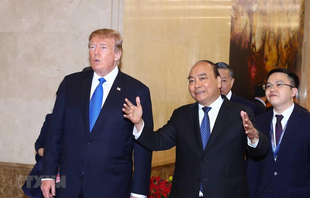 Thủ tướng Nguyễn Xuân Phúc hội kiến Tổng thống Hoa Kỳ Donald Trump nhân dịp sang Việt Nam dự Hội nghị thượng đỉnh Hoa Kỳ-Triều Tiên lần thứ hai. (Ảnh: Thống Nhất/TTXVN)