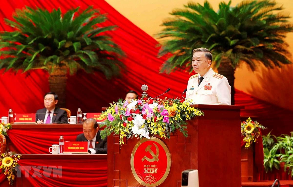 Đại tướng Tô Lâm, Ủy viên Bộ Chính trị, Bí thư Đảng ủy Công an Trung ương, Bộ trưởng Bộ Công an trình bày tham luận. (Ảnh: TTXVN)
