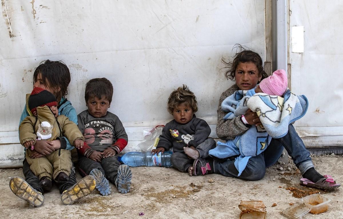 Người tị nạn tại một trại tạm ở tỉnh Hasakeh, Đông Bắc Syria ngày 18/3. (Ảnh: AFP/TTXVN)