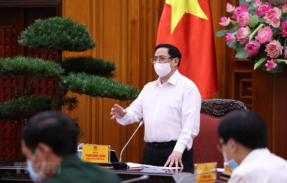 Thủ tướng Phạm Minh Chính yêu cầu thực hiện nghiêm túc các biện pháp phòng, chống dịch trong các khu công nghiệp. (Ảnh: Dương Giang/TTXVN)