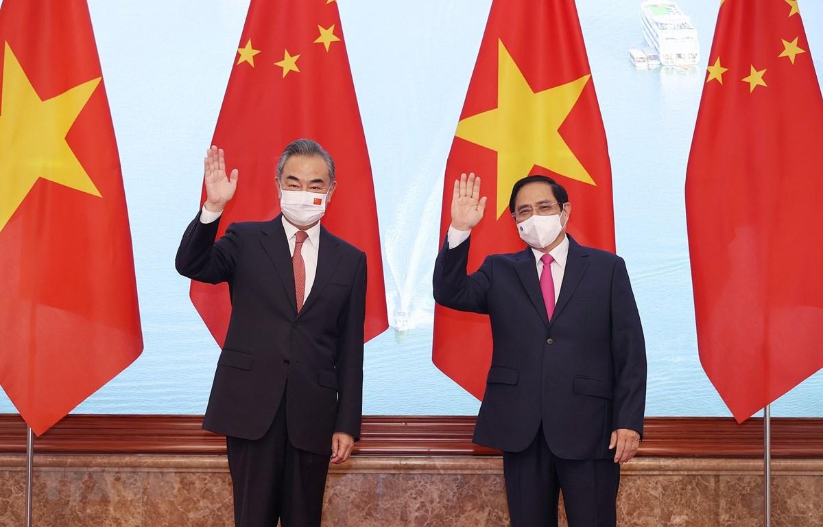 Thủ tướng Phạm Minh Chính tiếp Bộ trưởng Ngoại giao Trung Quốc Vương Nghị. (Ảnh: Dương Giang/TTXVN)