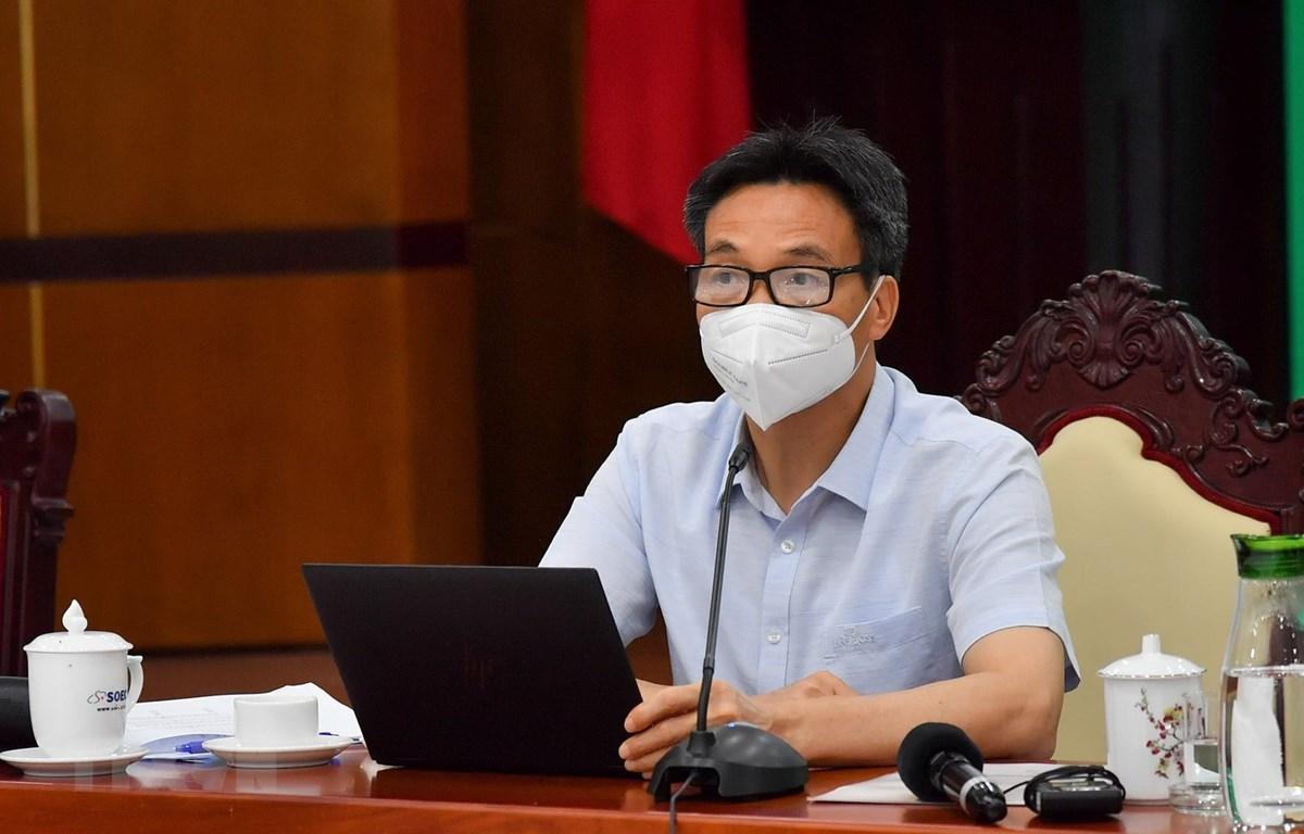 Phó Thủ tướng Vũ Đức Đam làm việc với lãnh đạo tỉnh Kiên Giang về công tác phòng, chống dịch COVID-19. (Ảnh: Hồng Đạt/TTXVN)