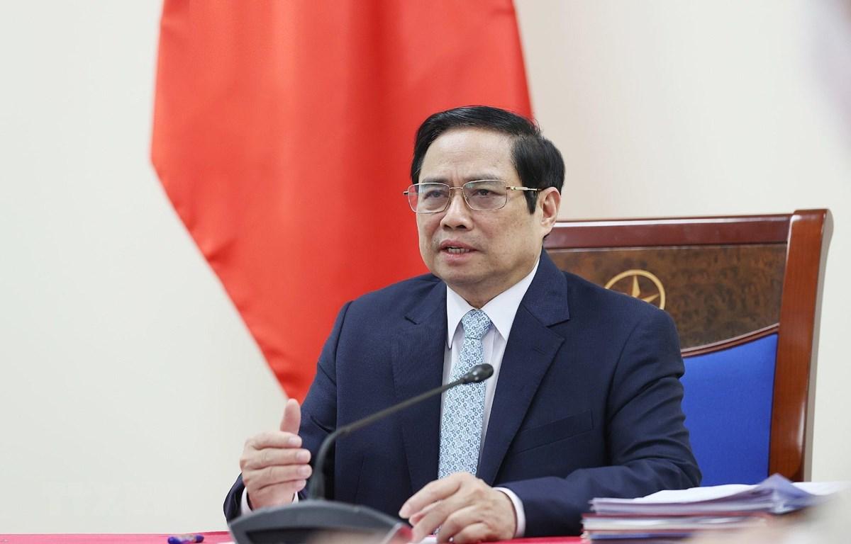 Thủ tướng Phạm Minh Chính phát biểu tại buổi điện đàm với bà Aurélia Nguyen, Giám đốc điều hành Chương trình COVAX. (Ảnh: Dương Giang/TTXVN)