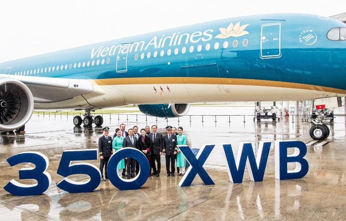 Lễ ra mắt máy bay Airbus A350-900 thứ 14 của Vietnam Airlines diễn ra dưới sự chứng kiến của Chủ tịch Quốc hội Việt Nam Nguyễn Thị Kim Ngân và các đại biểu trong Đoàn cấp cao Quốc hội Việt Nam. (Ảnh: Anh Tuấn)