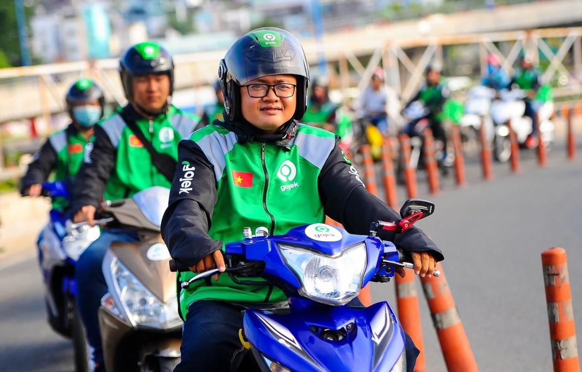 Tài xế chạy ứng dụng Gojek tại thị trường Việt Nam. (Ảnh: PV/Vietnam+)