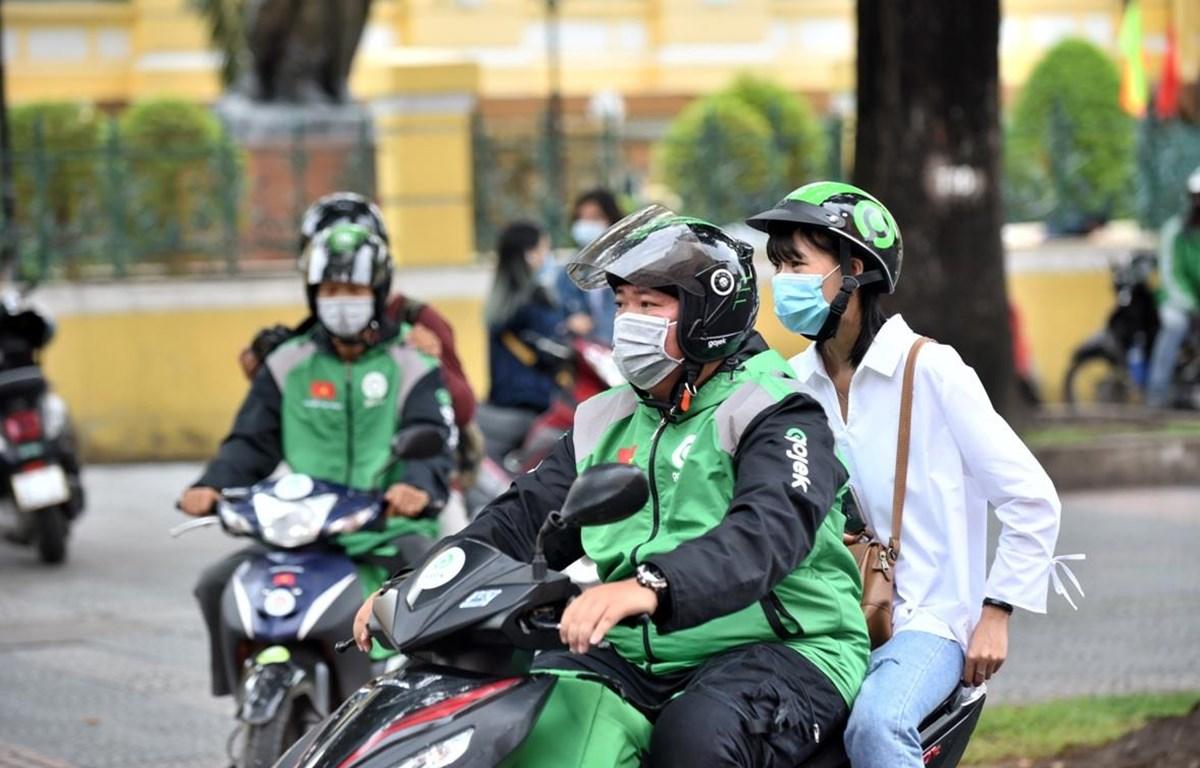 Gojek đưa ra chương trình chuyến xe đồng giá 8.000 đồng. (Ảnh: PV/Vietnam+)