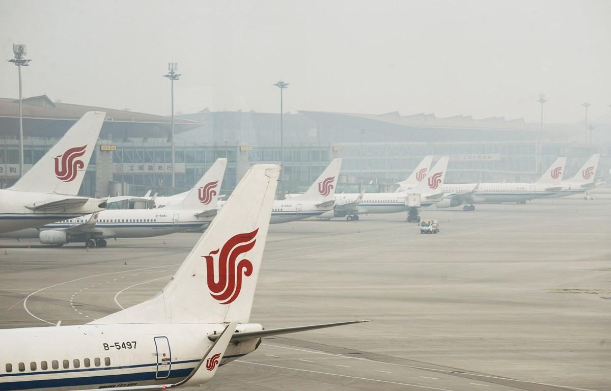 Máy bay của hãng hàng không Air China tại sân bay quốc tế Bắc Kinh, Trung Quốc. (Ảnh: AFP/TTXVN)