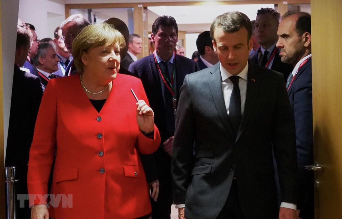 Thủ tướng Đức Angela Merkel (trái, phía trước) và Tổng thống Pháp Emmanuel Macron (phải, phía trước) tại Hội nghị thượng đỉnh Liên minh châu Âu ở Brussels, Bỉ ngày 21/3/2019. (Ảnh: THX/TTXVN)