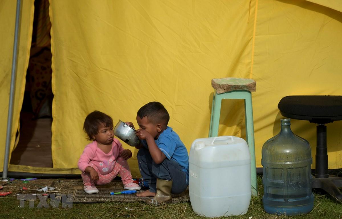 Trẻ em tị nạn Venezuela tại lều tạm ở Bogota, Colombia, ngày 9/1/2019. (Ảnh: AFP/TTXVN)