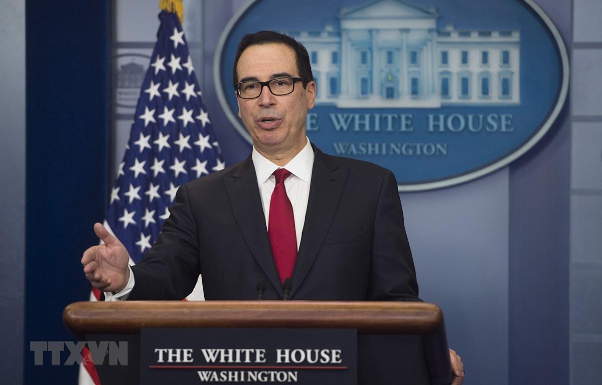Bộ trưởng Tài chính Mỹ Steven Mnuchin trong cuộc họp báo tại Nhà Trắng, Washington, DC. Ảnh: AFP/TTXVN