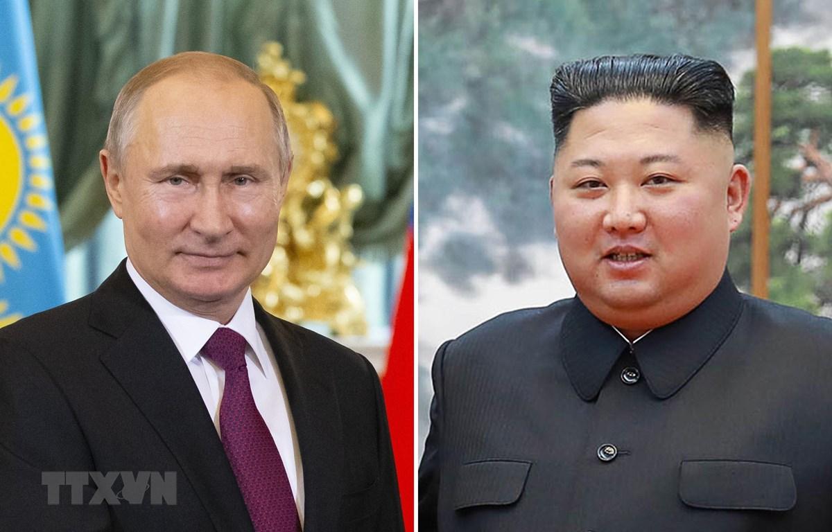 Tổng thống Nga Vladimir Putin (trái) và nhà lãnh đạo Triều Tiên Kim Jong-un. (Ảnh: AFP/TTXVN)