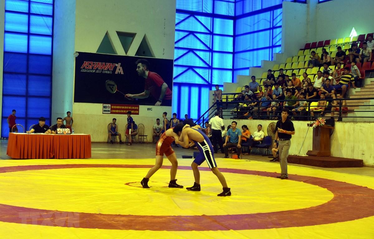 Các vận động viên thi đấu trong ngày khai mạc giải. (Ảnh Quang Đán/TTXVN)