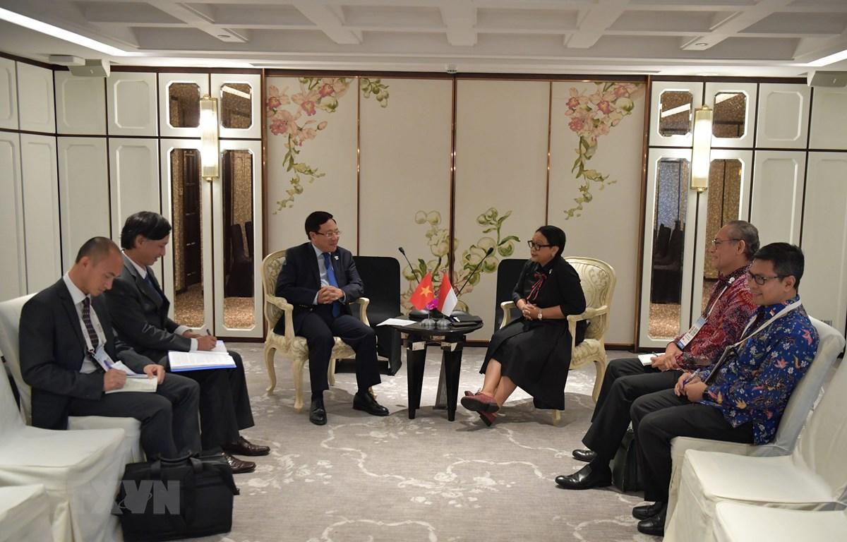 Phó Thủ tướng, Bộ trưởng Ngoại giao Phạm Bình Minh gặp Bộ trưởng Ngoại giao Indonesia Retno Marsudi. (Ảnh: PV/TTXVN)