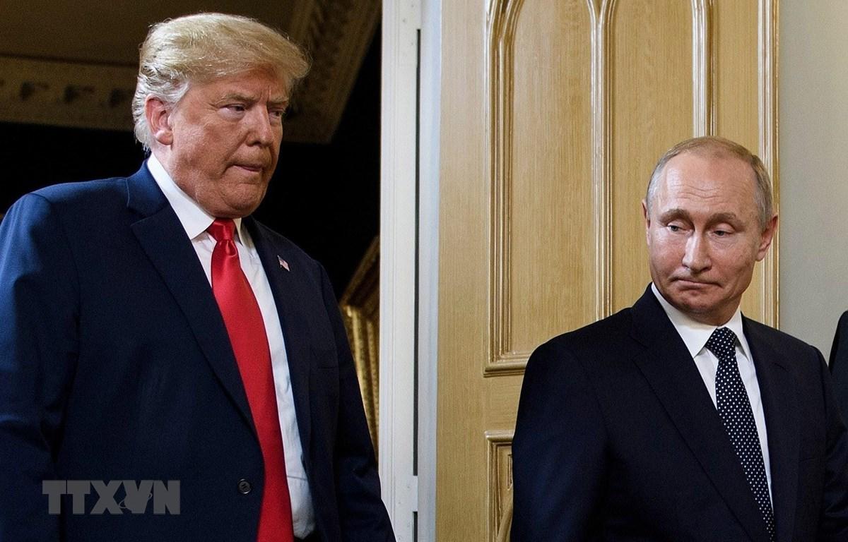Tổng thống Mỹ Donald Trump (trái) và Tổng thống Nga Vladimir Putin. (Ảnh: AFP/TTXVN)