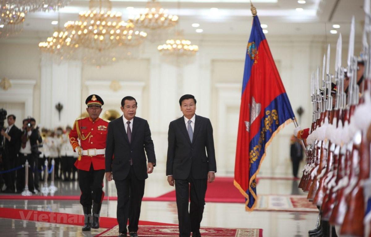 Lễ đón chính thức Thủ tướng Lào Thongloun Sisoulith tại cung Hòa Bình. (Nguồn: Fresh News)