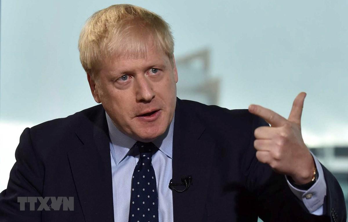 Thủ tướng Anh Boris Johnson trả lời phỏng vấn báo chí tại thành phố Manchester ngày 29/9/2019. (Ảnh: AFP/TTXVN)