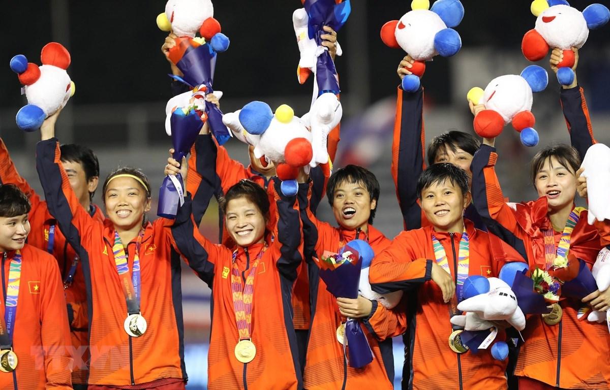 Đội tuyển nữ Việt Nam ăn mừng. (Ảnh: Hoàng Linh/TTXVN)