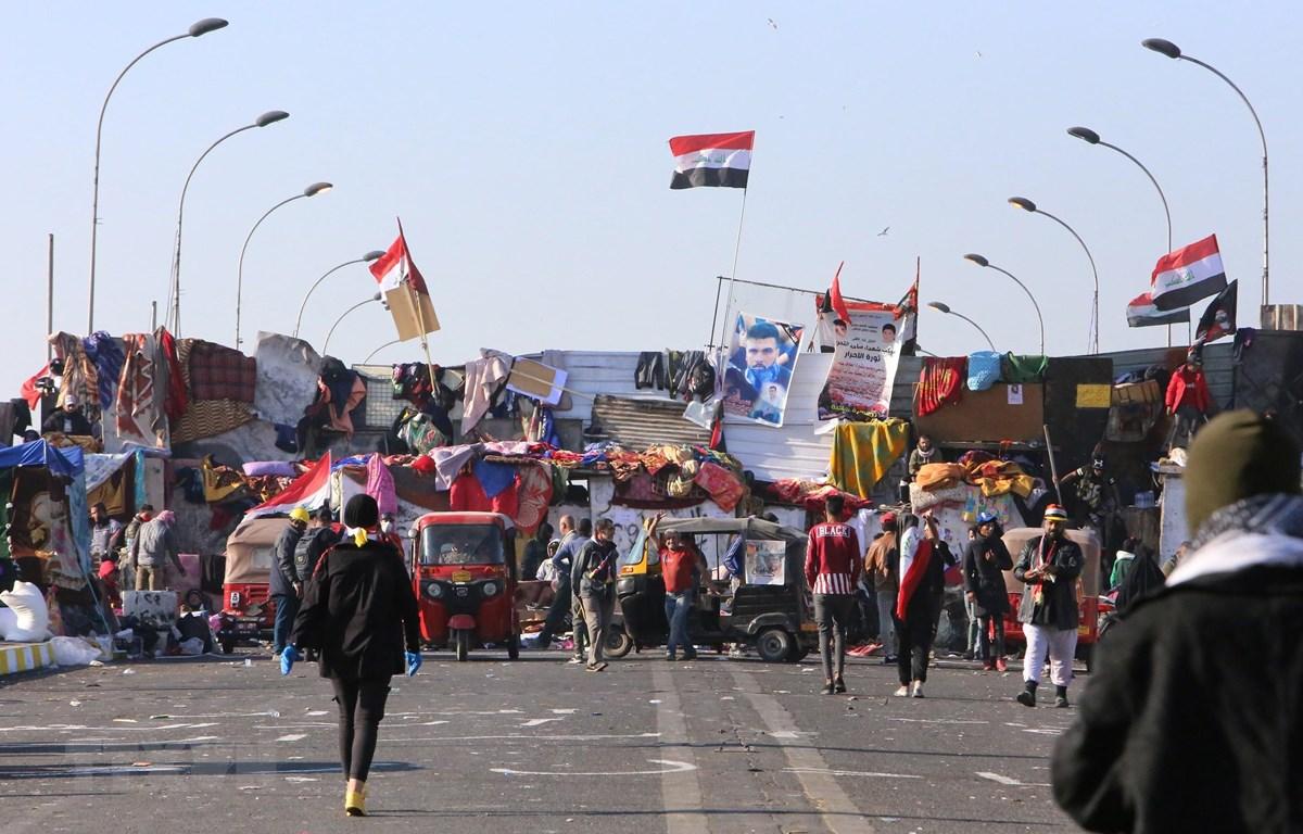 Người biểu tình tập trung tại Baghdad, Iraq, ngày 19/11/2019. (Ảnh: AFP/TTXVN)