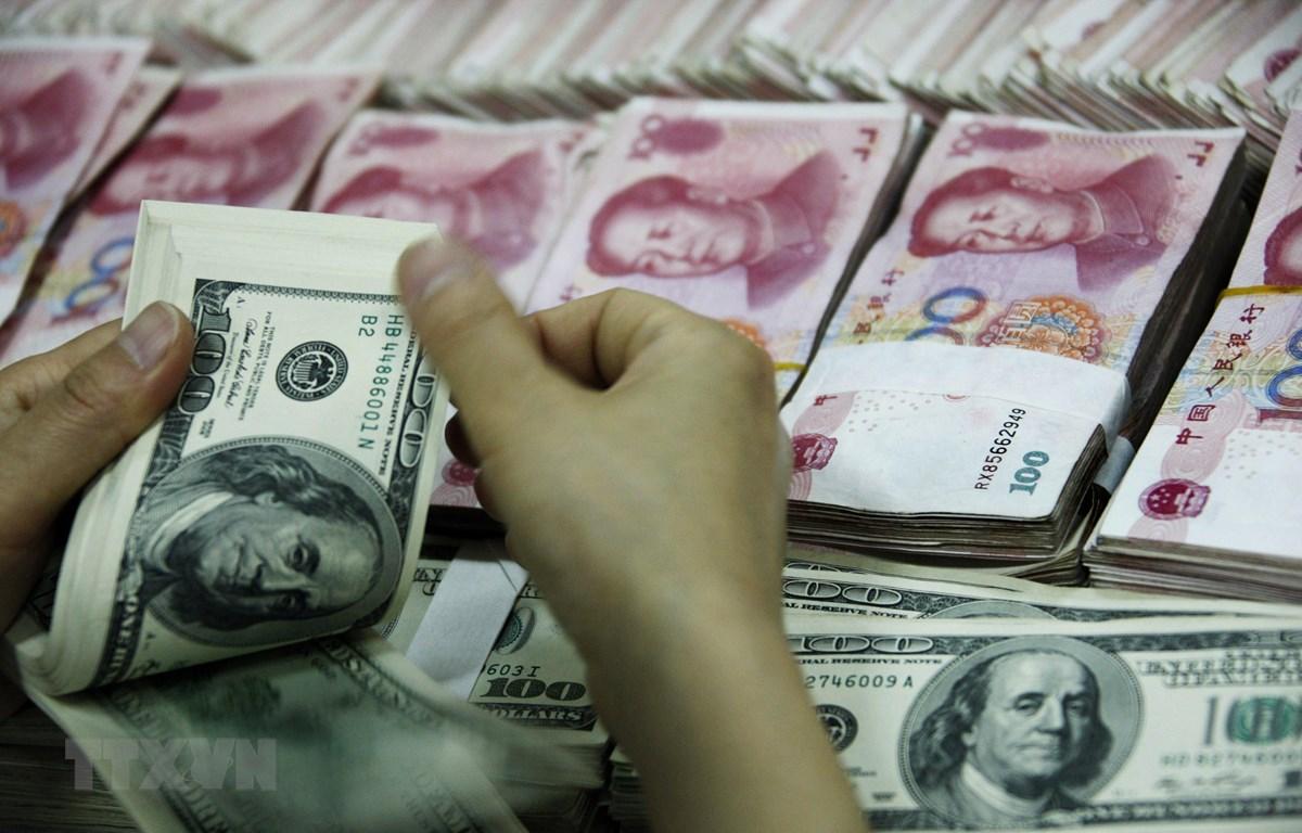 Hoạt động kinh tế tại Trung Quốc dự kiến sẽ tiếp tục phục hồi trong nửa cuối năm. (Ảnh: AFP/TTXVN)