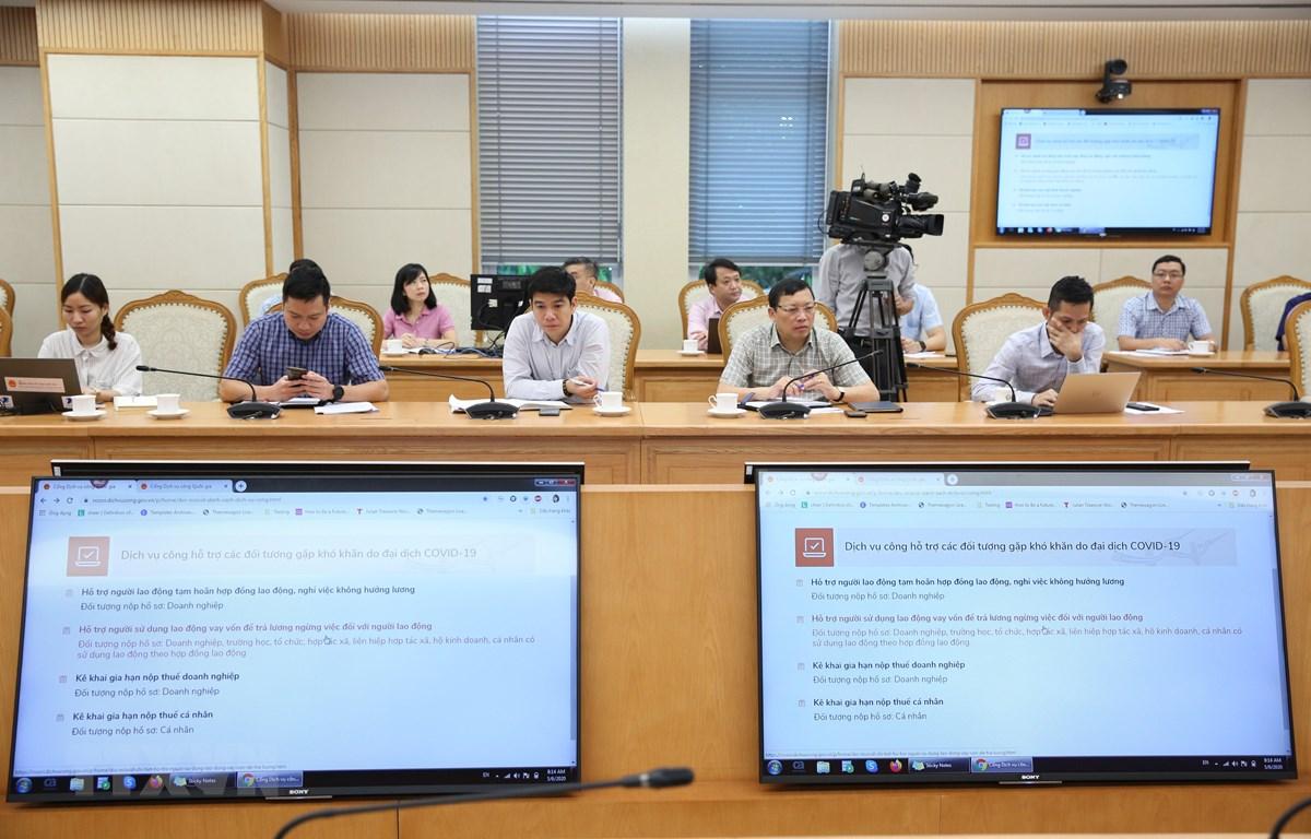 Trang thông tin hướng dẫn nộp thuế cá nhân và doanh nghiệp trên Cổng dịch vụ công Quốc gia. (Ảnh: Dương Giang/TTXVN)