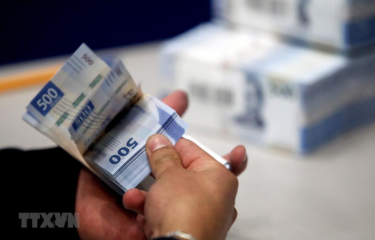 Đồng tiền giấy 500 pesos của Mexico. (Ảnh: AFP/TTXVN)