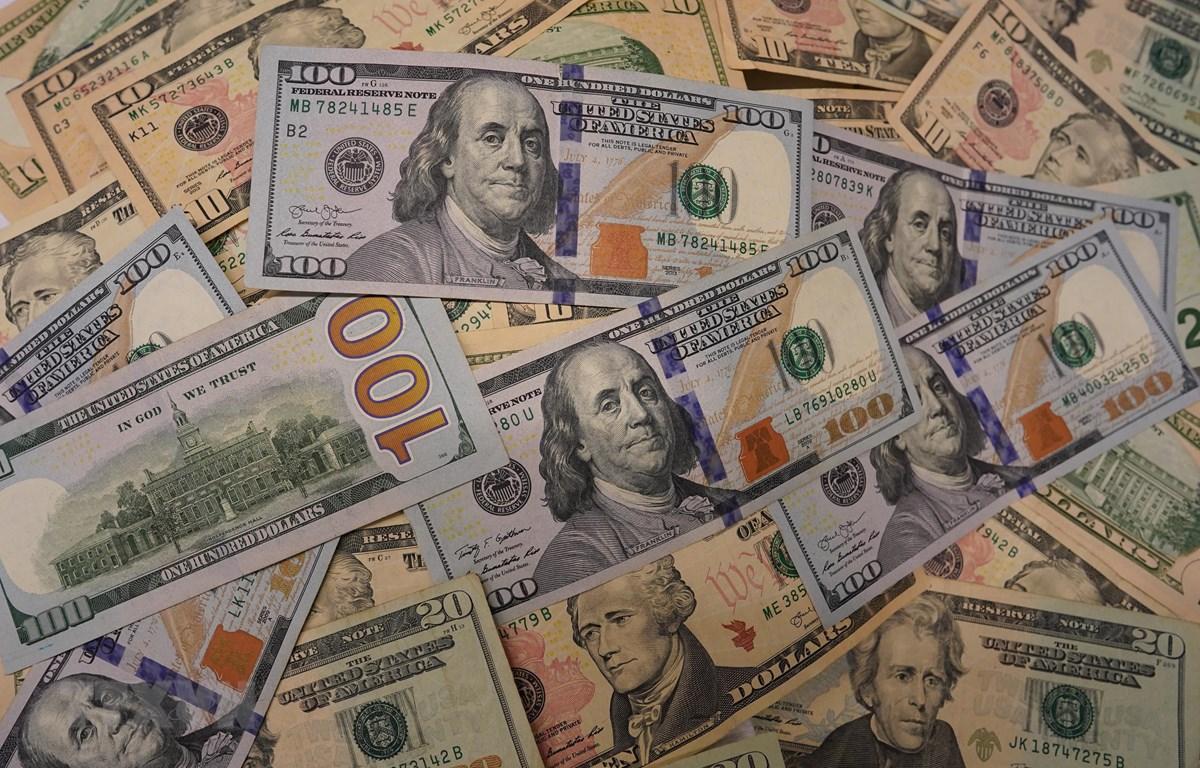 Đồng USD tại một ngân hàng ở Washington, DC. (Ảnh: THX/TTXVN)