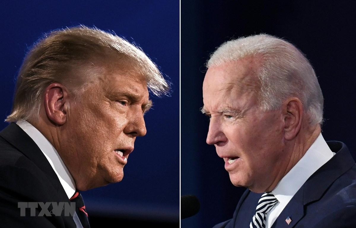 Tổng thống Mỹ Donald Trump (trái) và cựu Phó Tổng thống Mỹ Joe Biden (phải) tại vòng tranh luận trực tiếp đầu tiên ở thành phố Cleveland, bang Ohio ngày 29/9/2020. (Ảnh: AFP/TTXVN)