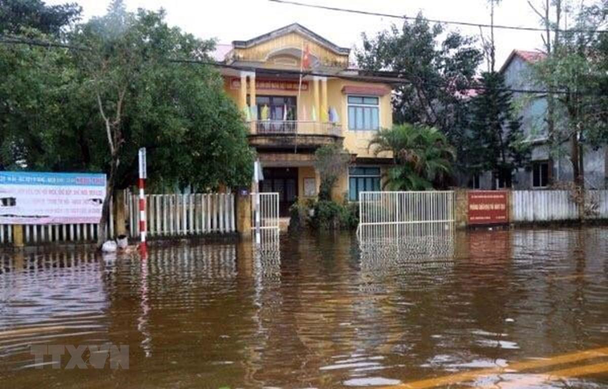 Nhiều xã ở huyện Quảng Điền bị ngập lụt sâu, trên diện rộng. (Ảnh: Đỗ Trưởng/TTXVN)