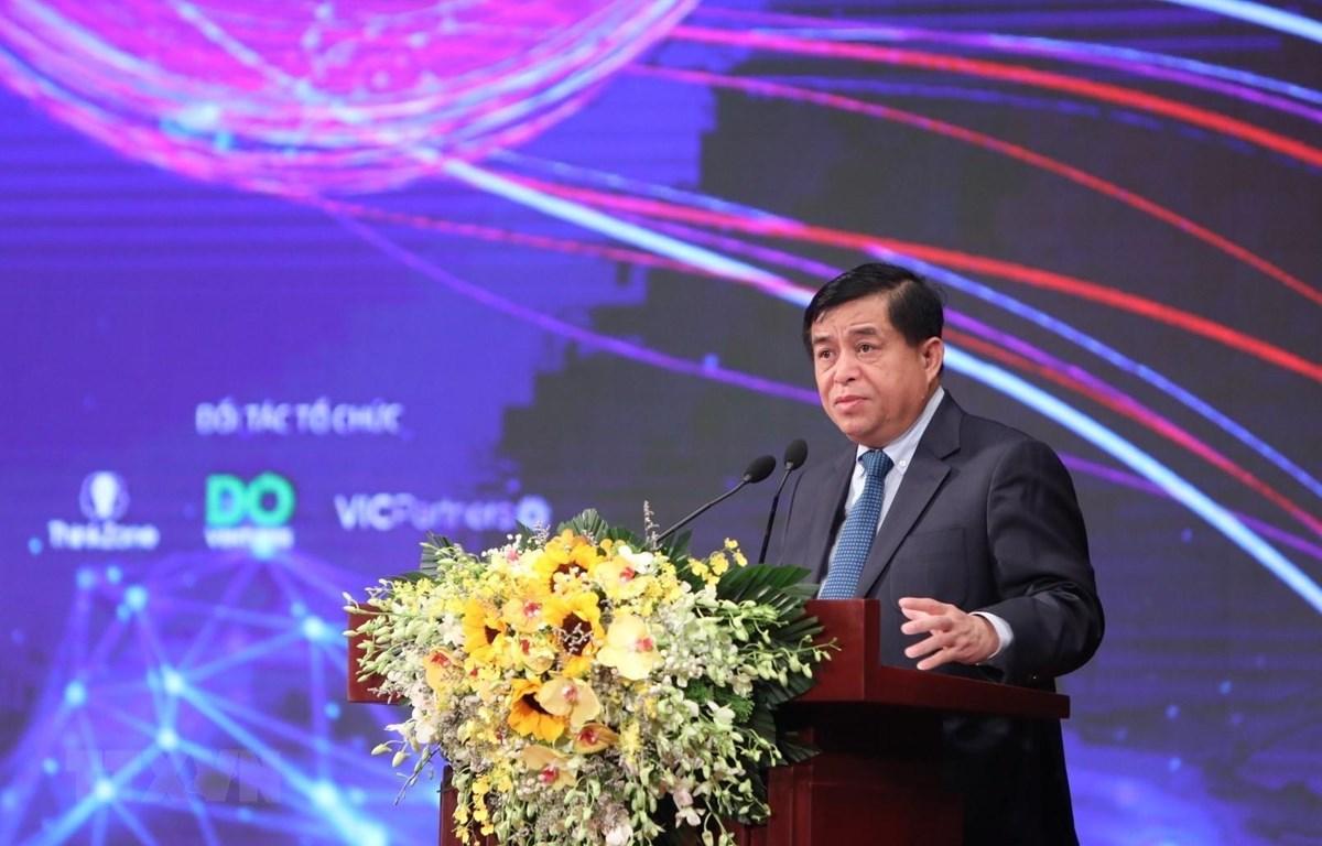 Bộ trưởng Bộ Kế hoạch và Đầu tư Nguyễn Chí Dũng phát biểu tại diễn đàn. (Ảnh: Danh Lam/TTXVN)