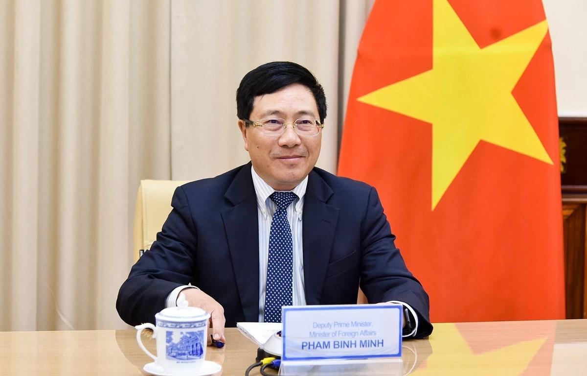 Phó Thủ tướng, Bộ trưởng Bộ Ngoại giao Phạm Bình Minh điện đàm với Bộ trưởng Ngoại giao Na Uy Ine Marie Eriksen Soreide. (Ảnh: TTXVN phát)