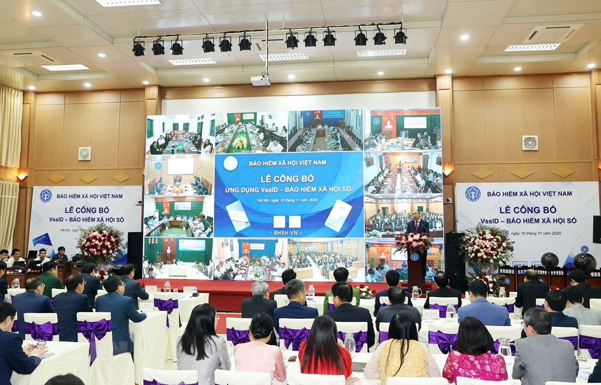"""Lễ công bố ứng dụng """"VssID - Bảo hiểm xã hội số"""" của Bảo hiểm xã hội Việt Nam. (Ảnh: Thống Nhất/TTXVN)"""