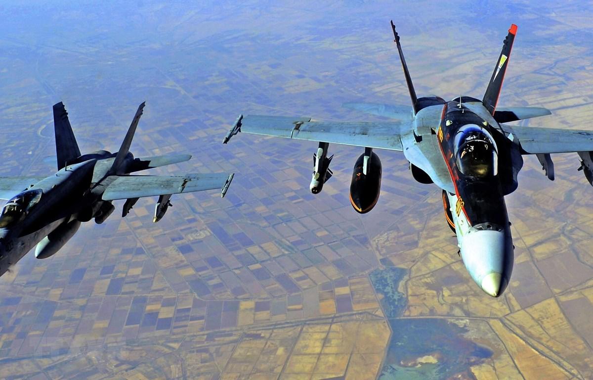 Các máy bay chiến đấu của Mỹ sau khi tiến hành một cuộc không kích. (Ảnh: AFP/TTXVN)