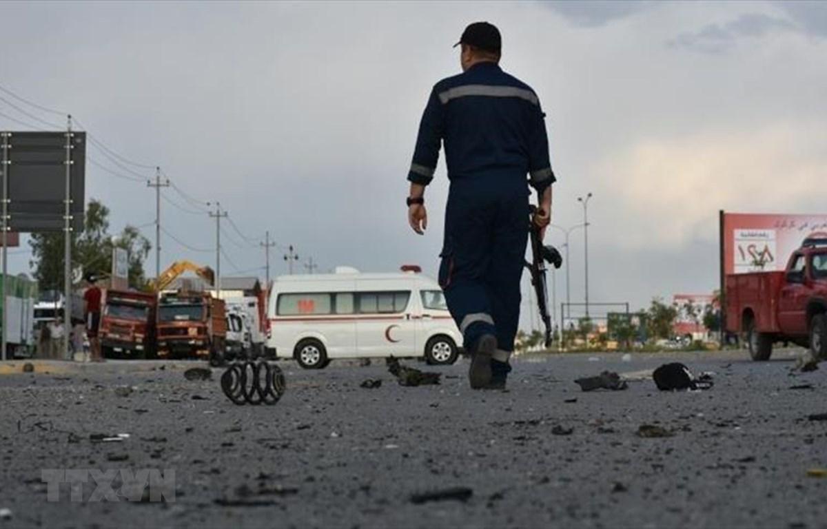 Hiện trường một vụ tấn công tại Baghdad, Iraq. (Ảnh: Anadolu Agency/TTXVN)