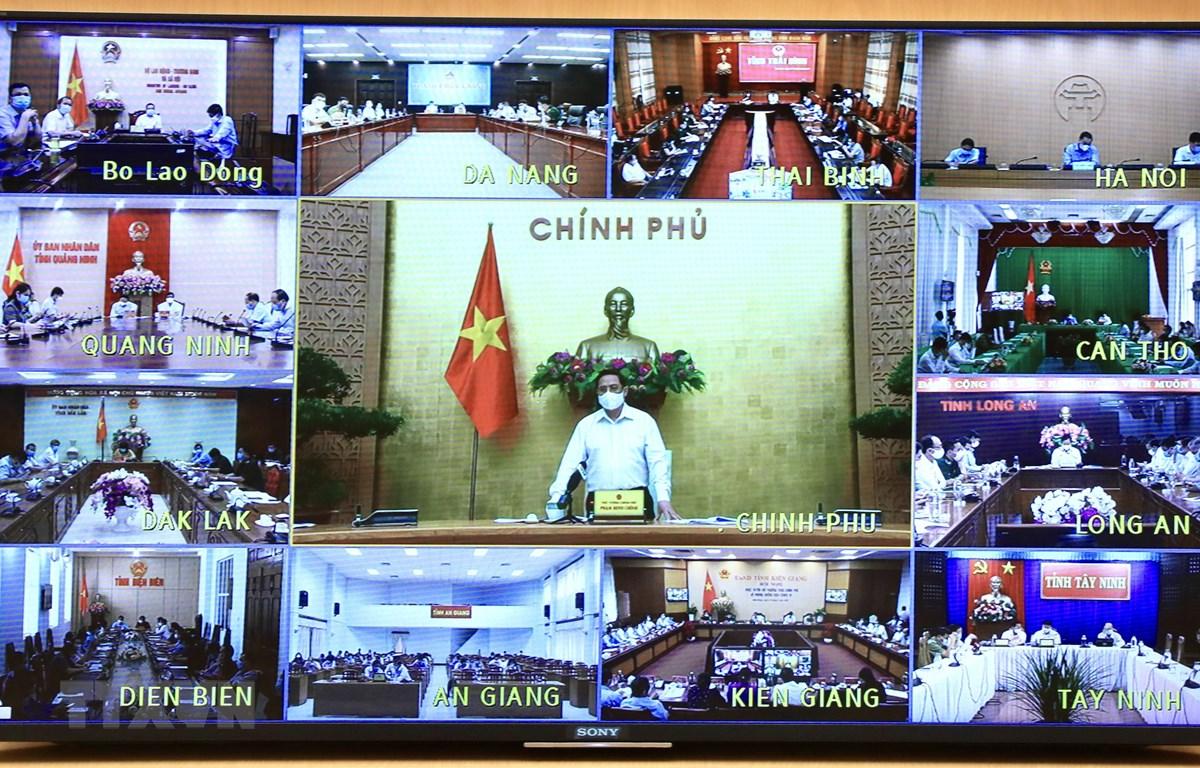 Thủ tướng Phạm Minh Chính chỉ đạo họp trực tuyến toàn quốc trước diễn biến mới của dịch COVID-19. (Ảnh: Lâm Khánh/TTXVN)