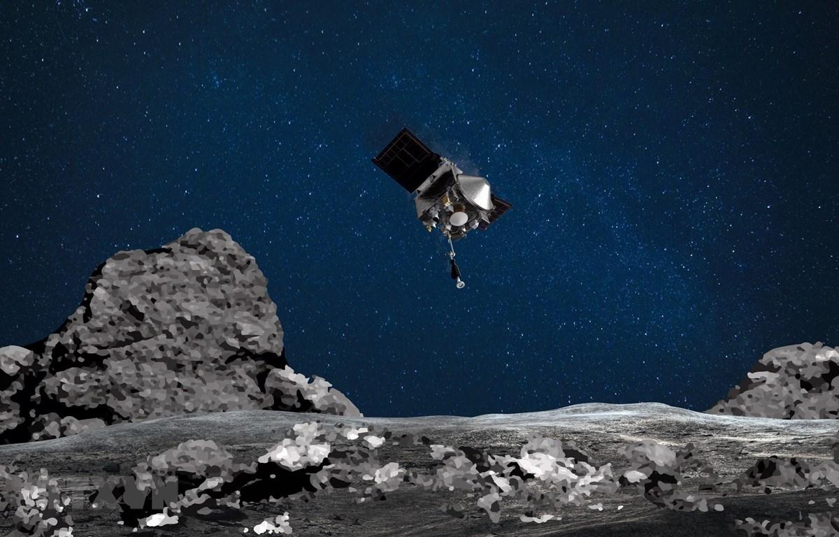 Tàu thăm dò Osiris-Rex của NASA đáp xuống bề mặt tiểu hành tinh Bennu để thu thập mẫu vật. (Ảnh: AFP/TTXVN)