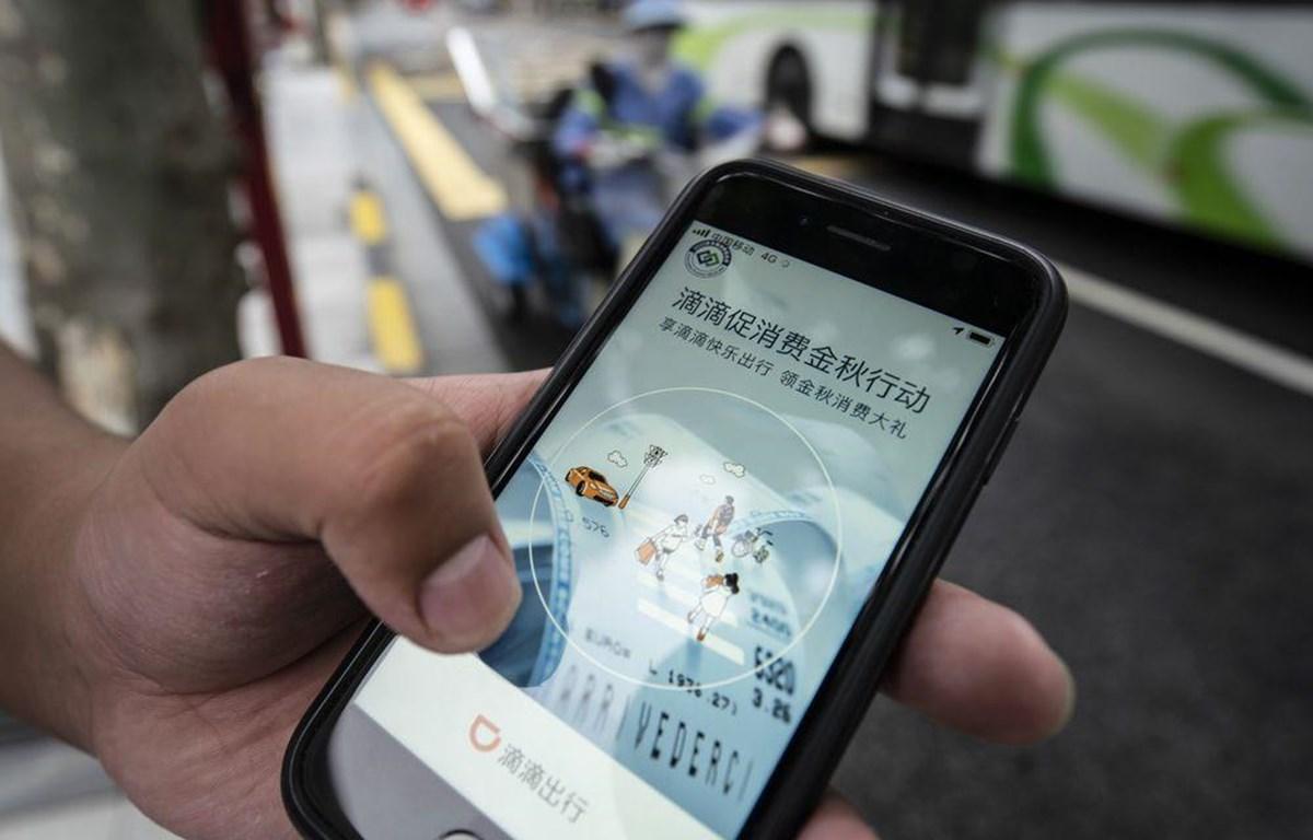 Ứng dụng đặt xe của Didi Global Inc trên điện thoại tại Trung Quốc. (Nguồn: Blooberg)